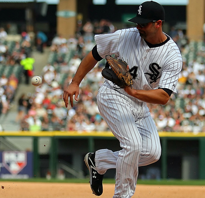 Paul Konerko snatches up a ground ball and contributes two home runs to the White Sox's win over the Rays. (AP)