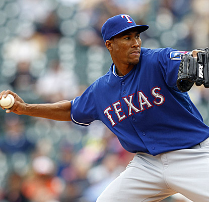 Rangers starter Alexi Ogando tosses a solid seven innings, with two hits and four strikeouts. (US Presswire)