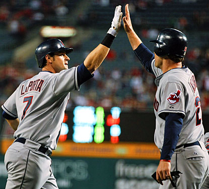 Matt LaPorta (left) celebrates his three-run home run with Austin Kearns in the second inning. (AP)