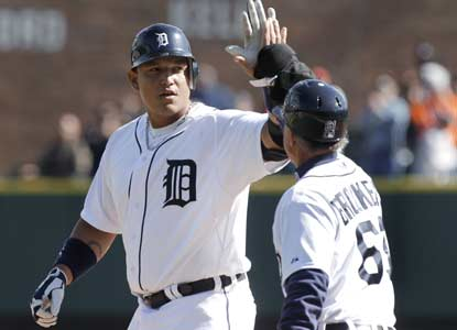 Miguel Cabrera gets praise after hitting a two-out, bases-loaded single in the bottom of the ninth for the Tigers. (AP)