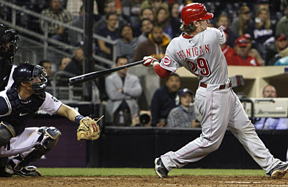 Ryan Hanigan's double drives in Jonny Gomes and starts the string of runs for Cincinnati in the 11th inning.  (AP)