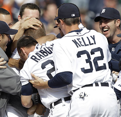 Brandon Inge, hidden in a swarm of teammates, is Detroit's latest ninth-inning hero after blasting a HR on the first pitch.  (AP)