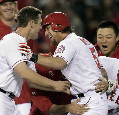 Teammates congratulate Jeff Mathis, whose bases-loaded sac fly in the 12th gives the Halos the win.  (AP)
