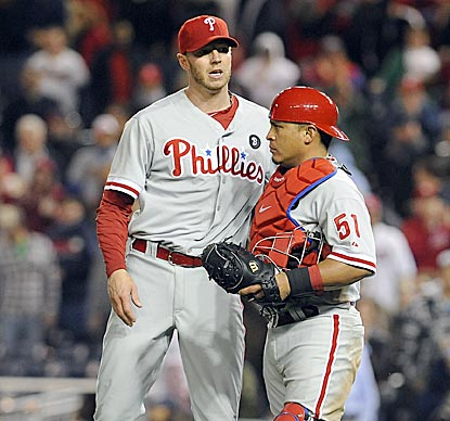 Roy Halladay thanks catcher Carlos Ruiz for helping him get through an unexpectedly difficult ninth inning.  (US Presswire)