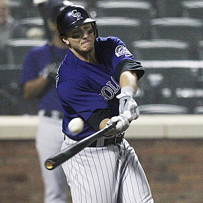 Troy Tulowitzki shows off his opposite-field power in the fifth inning with a three-run circuit clout to right field.  (AP)