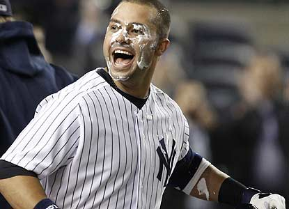 Nick Swisher is the most popular guy in the clubhouse after his sac fly in the 10th caps the Yanks' rally from five runs down. (AP)