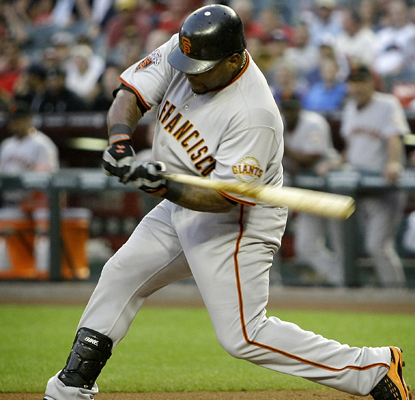 Pablo Sandoval provides offensive support to pitcher Matt Cain's strong outing with a three-run home run. (AP)