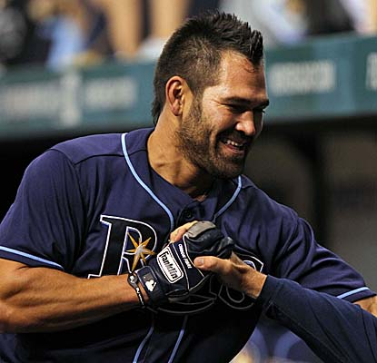 Johnny Damon gets congratulations from the Rays dugout after hitting a go-ahead single vs. the Twins. (US Presswire)