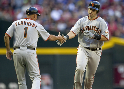 Buster Posey rounds the bases after hitting a two-run home run against the Diamondbacks in the first inning. (AP)