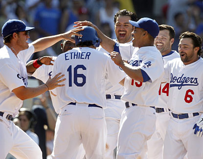 Los Angeles' Andre Ethier is mobbed at the plate after Matt Kemp's game-winning homer. (AP)