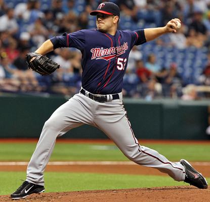 Brian Duensing delivers a pitch on his way to a strong performance against the Rays in which he allows two runs. (US Presswire)