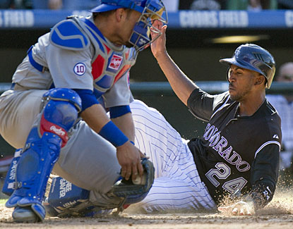Dexter Fowler slides past Chicago catcher Geovany Soto to score in the eighth inning. (AP)