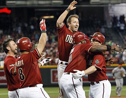 Arizona's Stephen Drew (right) celebrates his game-winning hit in the 12th inning. (AP)
