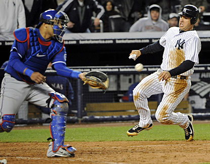 New York's Mark Teixeira scores the game-winner on a single by Eric Chavez in the eighth inning. (AP)