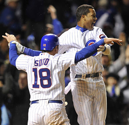 Geovany Soto, who represents the winning run, rejoices with Starlin Castro after the Cubs win in walk-off style in the 10th. (AP)
