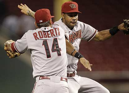 Ryan Roberts, who records a multihomer game after filling in at third base for Melvin Mora, jumps for joy with Chris Young. (AP)