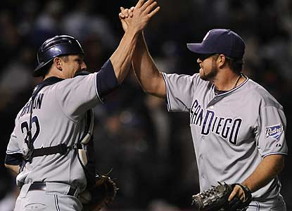 Catcher Rob Johnson and closer Heath Bell celebrate the win in which the Padres lead all the way. (AP)
