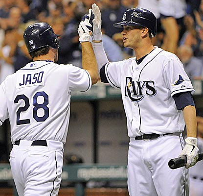 The Rays' John Jaso celebrates at the plate with Reid Brignac after his second-inning dinger. (AP)