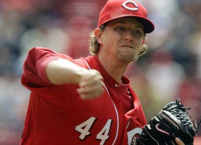 Despite nasty signs regarding his recent shoplifting arrest, Mike Leake K's six over seven solid innings. (AP)
