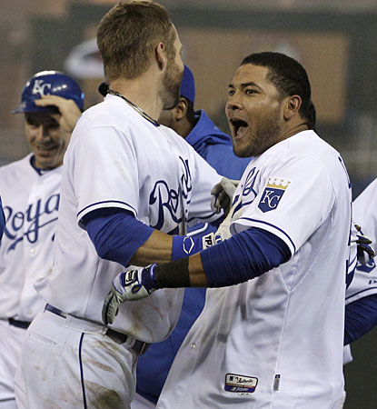 Melky Cabrera (right) celebrates with Alex Gordon after hitting a two-run single in the ninth. (AP)