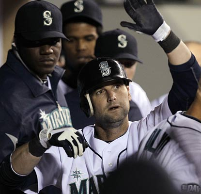 Adam Kennedy gets props in the dugout following his solo home run, the only score in the game.  (AP)