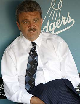 For Ned Colletti, not much has changed since MLB took over the Dodgers: 'I still report to Frank [McCourt],' the GM says. (AP)