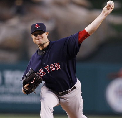 Jon Lester pitches six scoreless innings and his bullpen holds up to give him his second win as the Red Sox top the Angels. (AP)