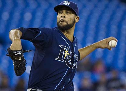 Despite giving up eight hits in eight-plus innings, David Price improves to 7-0 with a 2.30 ERA in eight starts vs. Toronto. (AP)