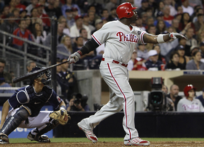 Ryan Howard blasts the RBI double that puts the Phillies ahead of the Padres for good in the 11th inning. (AP)