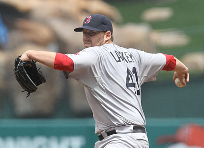 John Lackey riddles his former team by striking out six batters throughout eight shutout innings. (Getty Images)