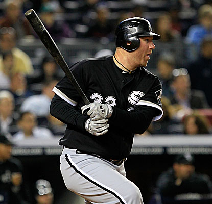 Sporting a .145 batting average coming into Monday's game, Adam Dunn grounds out to bring in a run. (Getty Images)