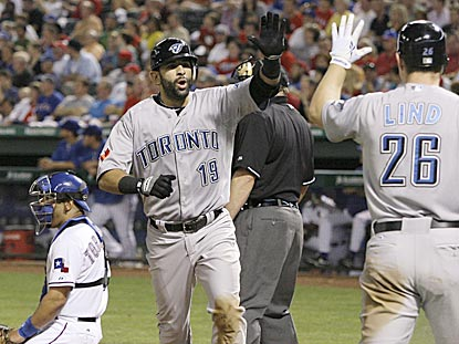 Jose Bautista receives congratulations from Adam Lind after belting his MLB-leading eighth home run in the fifth inning.  (AP)