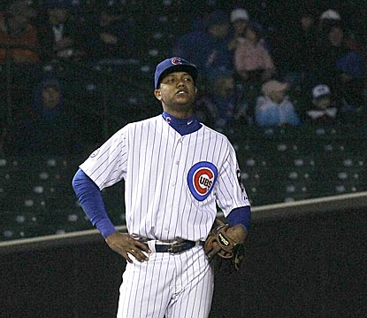 It's a lonely feeling for young Cubs shortstop Starlin Castro after he commits his third error of the second inning.  (AP)