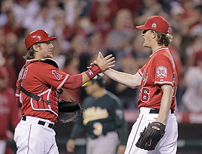 Angels catcher Jeff Mathis congratulates Jered Weaver, who on April 25 becomes the fastest pitcher in MLB history to be 6-0.  (AP)