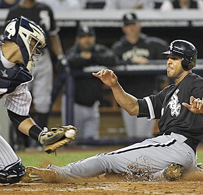Chicago's Alex Rios scores ahead of the tag of New York's Gustavo Molina in the fifth inning. (AP)