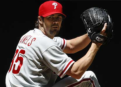 Cole Hamels K's eight in seven innings for Philly, which notches its 16th April win, one shy of the club record. (AP)