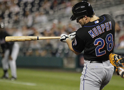 Daniel Murphy hits an  RBI double in the ninth inning after hitting a pinch-hit, game-tying home run in the eighth. (AP)