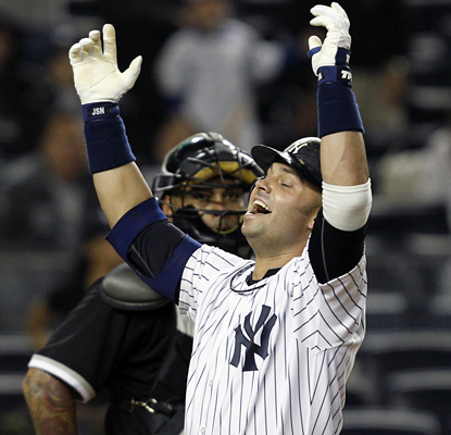 Nick Swisher celebrates hitting a two-run home run in the seventh inning of a game in which he has four RBI. (AP)