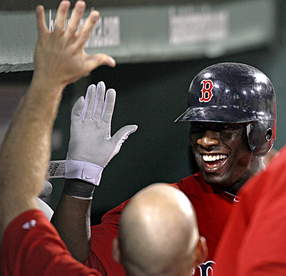 Mike Cameron is greeted with high-fives from teammates after belting his second solo HR in a home loss for the Red Sox. (AP)