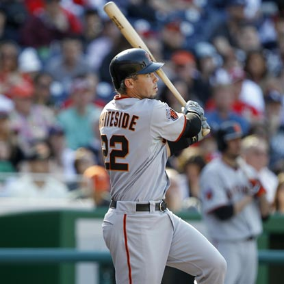 Eli Whiteside follows through on a critical solo shot in the third inning -- helping San Francisco survive Washington.  (Getty Images)