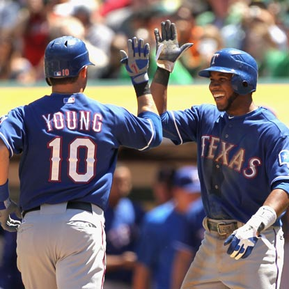 Michael Young celebrates his first home run of the season with teammate Elvis Andrus. (Getty Images)