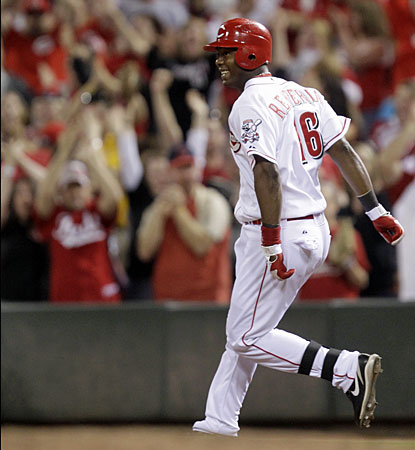 Cincinnati's Edgar Renteria watches his single that scores the winning run in the 10th inning.  (AP)