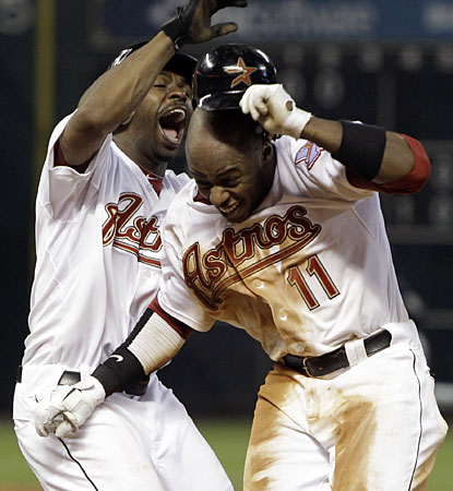 Michael Bourn (left) congratulates Jason Bourgeois on his game-winning single in the ninth inning. (AP)