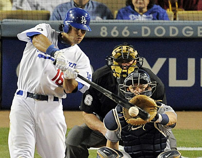 Andre Ethier smacks a single during the eighth inning. Ethier extends his hitting streak to 26 games.  (AP)
