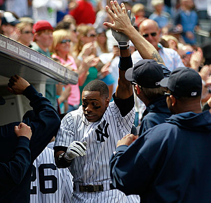 Curtis Granderson gets congratulations from Yankee teammates following his three-run homer in the fifth inning vs. Toronto. (AP)