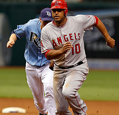 Vernon Wells gets caught in a run-down in the eighth inning as the Angels rally for the win. (AP)