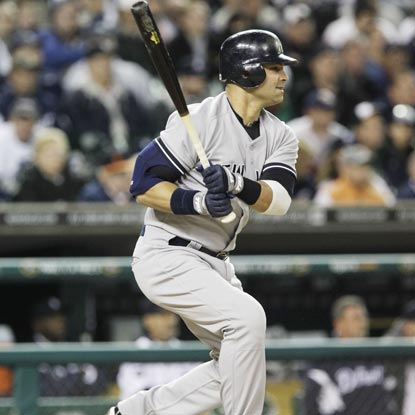 Nick Swisher follows through on a tie-breaking single in the ninth against Tigers closer Jose Valverde.  (Getty Images)