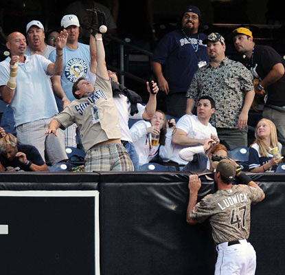 The Padres' Ryan Ludwick can only watch as a ball hit by Chris Snyder goes over the left field wall.  (US Presswire)