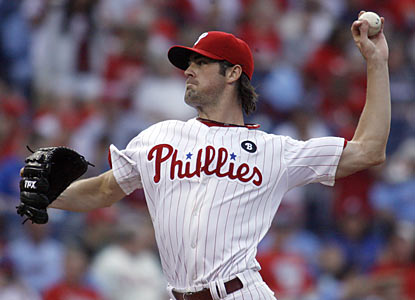 Cole Hamels throws 79 of 108 pitches for strikes, including 25 of 31 first-pitch strikes, and lowers his ERA to 2.66.  (AP)