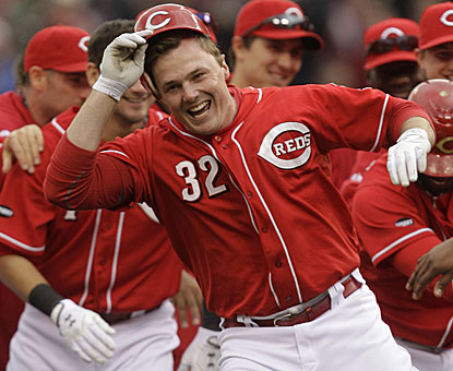 Jay Bruce receives praise after pulling a double just inside first base to cap the Reds' three-run rally in the ninth. (AP)